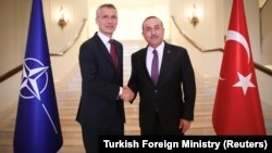 NATO Secretary-General Jens Stoltenberg meets with Turkish Foreign Minister Mevlut Cavusoglu in Ankara on May 6.