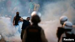 Përleshjet e policisë me protestuesit gjatë një demonstrate në një qytet të Brazilit
