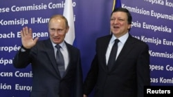 The talks between Russia's Prime Minister Vladimir Putin (left) and European Commission President Jose Manuel Barroso were less congenial.