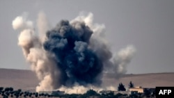 Smoke billows following air strikes by a Turkish Army jet fighter on the Syrian Turkish border village of Jarabulus during fighting against IS targets on August 24.