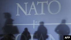 France -- shadows on a wall with NATO decor in Strasbourg ahead of 3-4 April 2009 summit, 02Apr2009