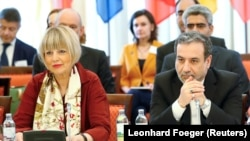 Iranian top nuclear negotiator Abbas Araqchi (R) and Helga Schmit , Secretary-General of the European External Action Service (EEAS), attend a meeting of the JCPOA Joint Commission in Vienna, June 28, 2019