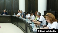Armenia - Prime Minister Hovik Abrahamian (L) meets with representatives of Nairit plant workers demonstrating outside his office, Yerevan, 9Jun2015.