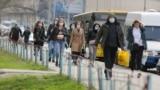 Ukraine -- people wear medical mask in Obolon district, Kyiv, 21Mar2020