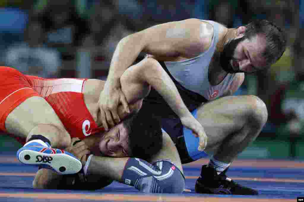 Abdulrashid Sadulaev of Russia (in red) in action against Selim Yasar of Turkey during the wrestling men's freestyle 86-kilogram gold medal bout. Sadulaev defeated Yasar, taking the gold. Bronze medals went to Azerbaijan's Sharif Sharifov and American J'Den Cox.