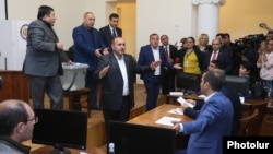 Armenia - Pro-government and opposition councilors argue during the election of mayor of Vanadzor, 10Oct2016.