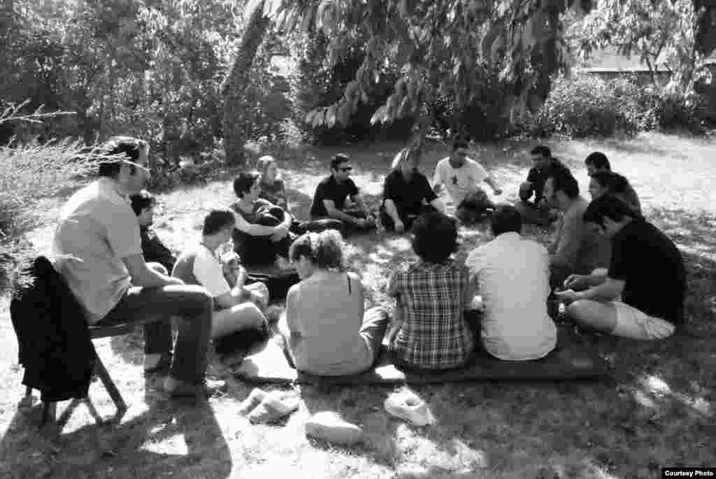 A gathering of some of the members of the Network during one of their occasional group get-aways. Members came together to discuss issues, re-group, and strategize away from the distractions of city life.