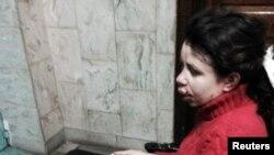 Татьяна Чорновил в инвалидном кресле после нападения на нее 25 декабря 2013 года