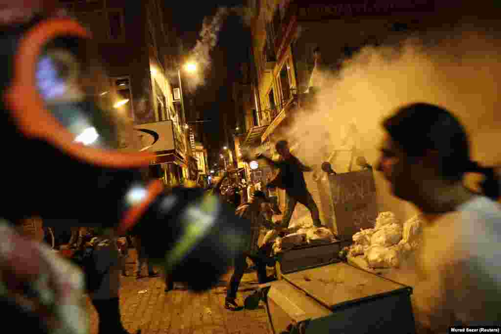 Antigovernment protesters clash with riot police near the prime minister's office in Istanbul, Turkey, on June 2. Demonstrations on Istanbul's Taksim Square that began as a protest against local development plans in May rapidly spread after a violent police crackdown.