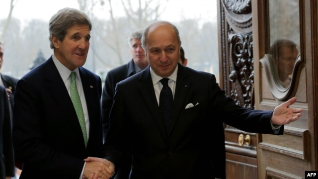 U.S. Secretary of State John Kerry (left) is welcomed by French Foreign Affairs Minister Laurent Fabius at the Quai d'Orsay Ministry in Paris on February 27.