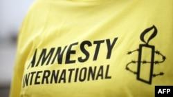 """""""Amnesty International"""" guramasynyň belgisi"""