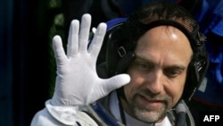 U.S. space tourist Richard Garriott waves as he boards the spacecraft at the Baikonur Cosmodrome in Kazakhstan.