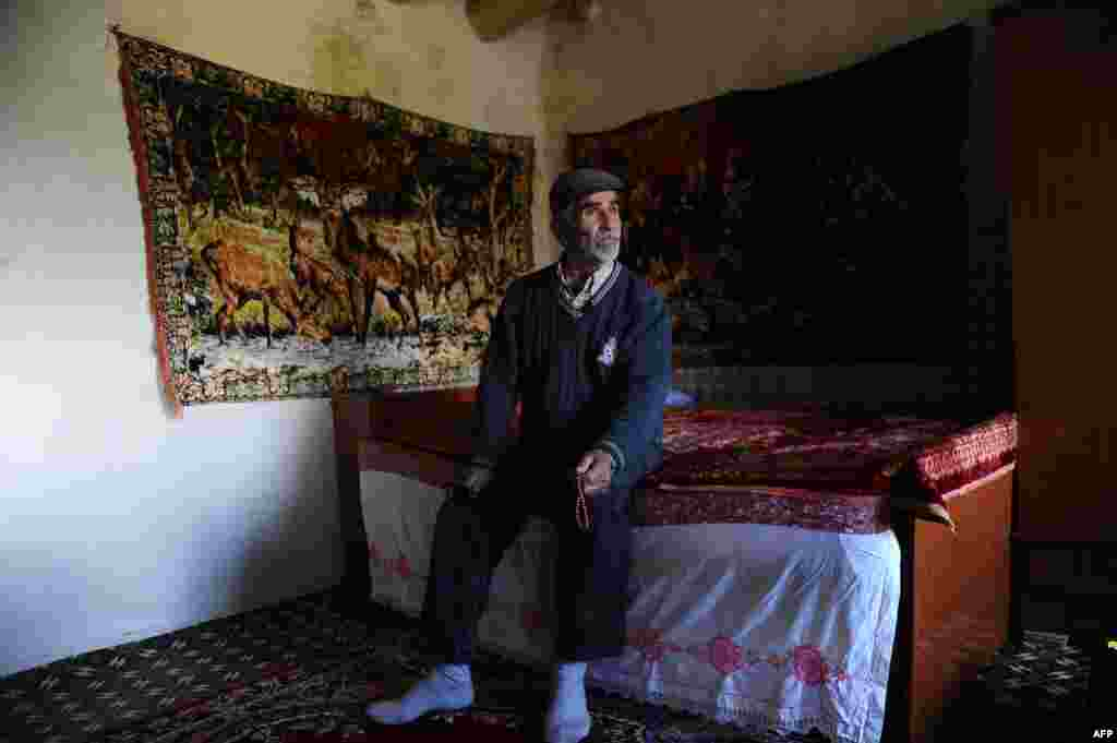 Ibrahim Boztas, 79, sits in his home in Mazgirt in Tunceli Province.