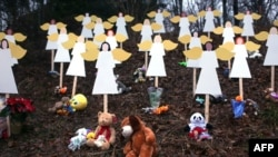 Twenty seven wooden angels stand in a yard down the street from the Sandy Hook School in Newtown, Connecticut, as a mark of respect for the massacre that occurred there on December 14.