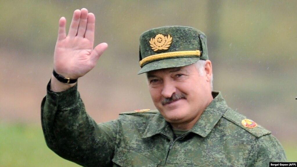 Belarus's president, Alyaksandr Lukashenka, waves as he arrives to inspect joint Russian-Belarusian military exercises near the town of Borisov on September 20.