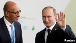 Harlem Desir (L) with Russian President Vladimir Putin in 2015 when he was a French state secretary