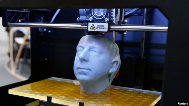 A 3D printer produces a sculpture at the CeBit computer fair in Hannover earlier this year.