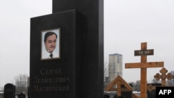 The grave of lawyer Sergei Magnitsky with his portrait on the tomb at the Preobrazhenskoye cemetery in Moscow.