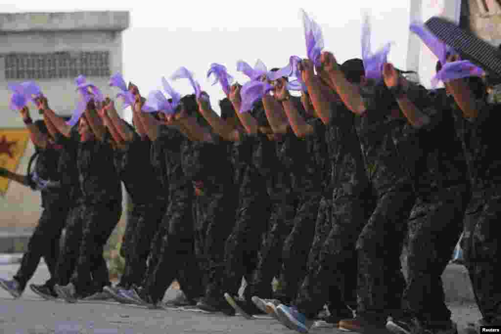 Kurdish female fighters of the Women's Protection Unit (YPJ) perform a folkloric dance at a military camp in the Syrian city of Ras al-Ain in Hasakah Province. (Reuters/Rodi Said)