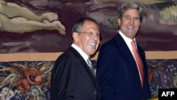Russian Foreign Minister Sergei Lavrov (left) and U.S. Secretary of State John Kerry at an earlier meeting, at UN headquarters in Geneva on September 13.