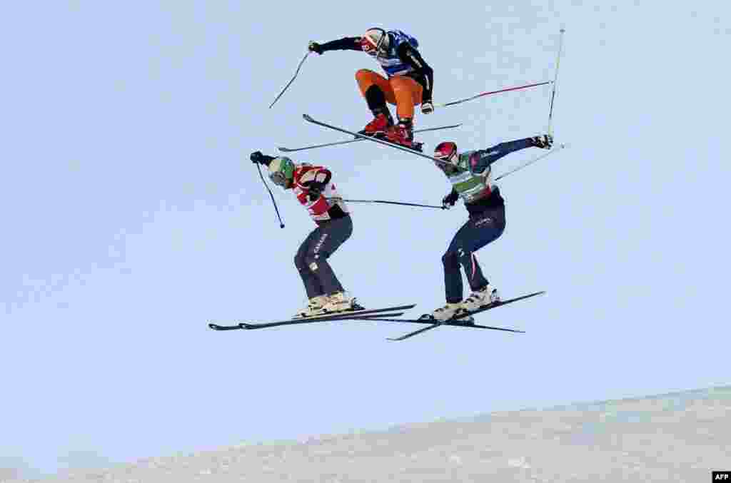 Brady Leman of Canada, Andreas Matt of Austria, and Daniel Bohnacker of Germany compete during the semifinal of the FIS men's Skicross World Cup at the Val Thorens ski resort in the French alps. (AFP/Philippe Desmazes)