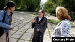 Kyrgyzstan -- Jusupjan (left) interviews women in Osh, November 11, 2011.