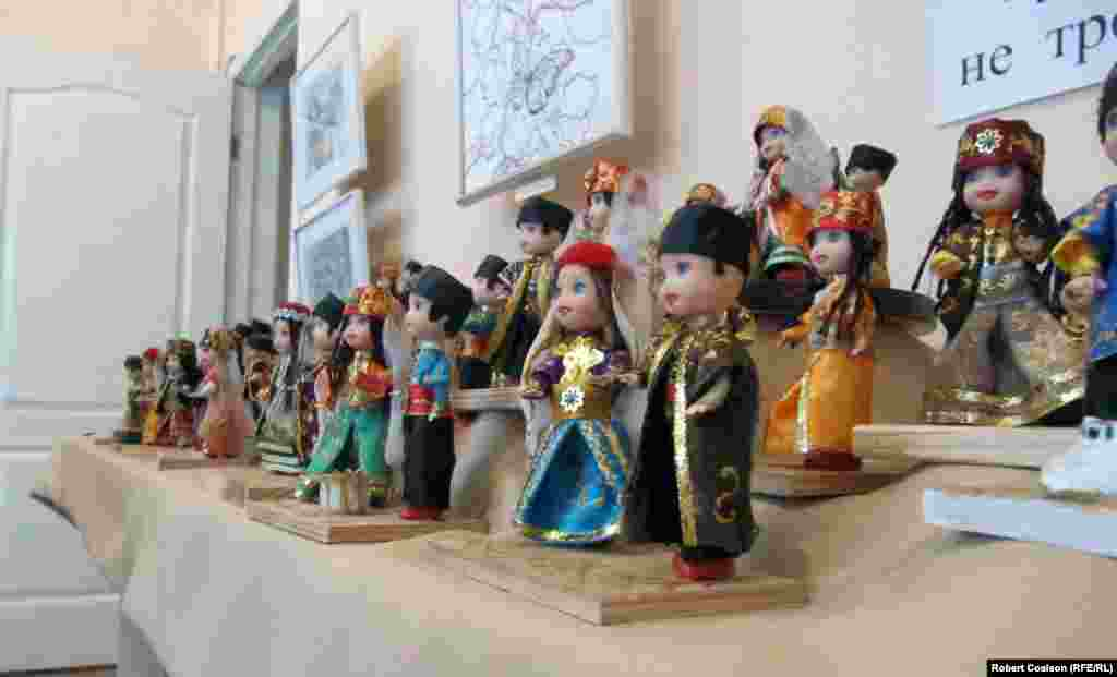 Dolls in traditional costumes at a Tatar art and culture museum in Semferopol.