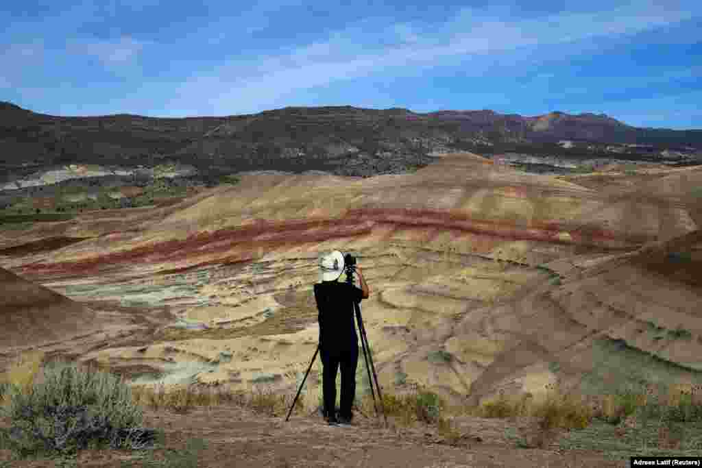 San Francisco Bay area resident Brian Martin photographs the Painted Hills, a unit of the John Day Fossil Beds National Monument, in preparation for the total lunar eclipse near Mitchell, Oregon, on August 20. (Reuters/Adrees Latif )