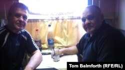 RFE/RL's Tom Balmforth joins two Berkut veterans on the train journey to Kyiv from Donetsk.