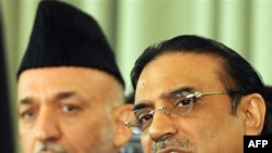 Pakistani President Asif Ali Zardari (right) is looking to forge closer relations with his Afghan counterpart, Hamid Karzai.