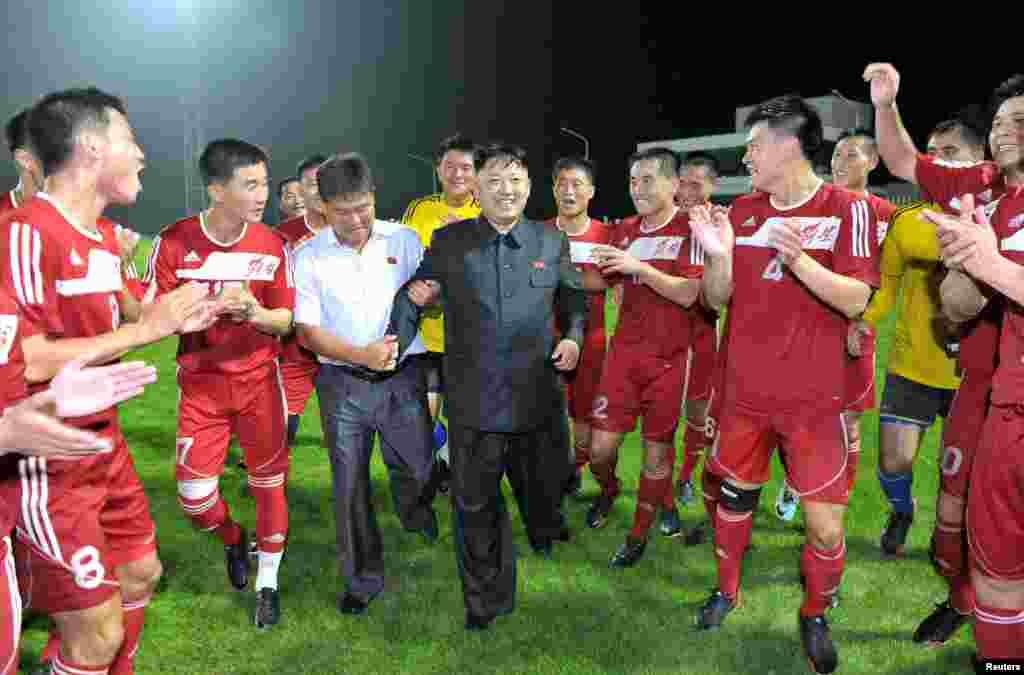 North Korean leader Kim Jong Un is applauded by players from the Hwaebul Team during their men's soccer match against the April 25 Team in Pyongyang. (Reuters/KCNA)