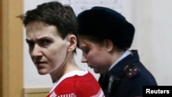 Ukrainian military pilot Nadia Savchenko is escorted inside a court building as she attends a hearing in Moscow on March 4.