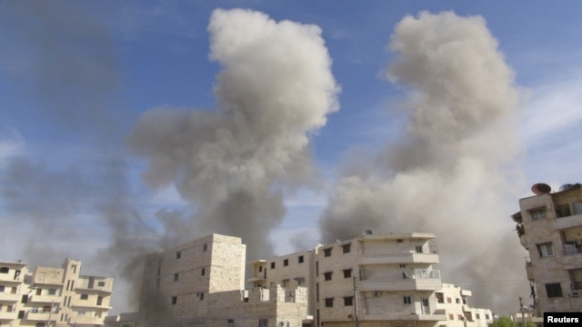 Smoke rises after a Syrian government fighter jet fired missiles at Marat al-Numan, near the northern province of Idlib, on October 30.