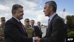 Візит генсекретаря НАТО до України у фотографіях