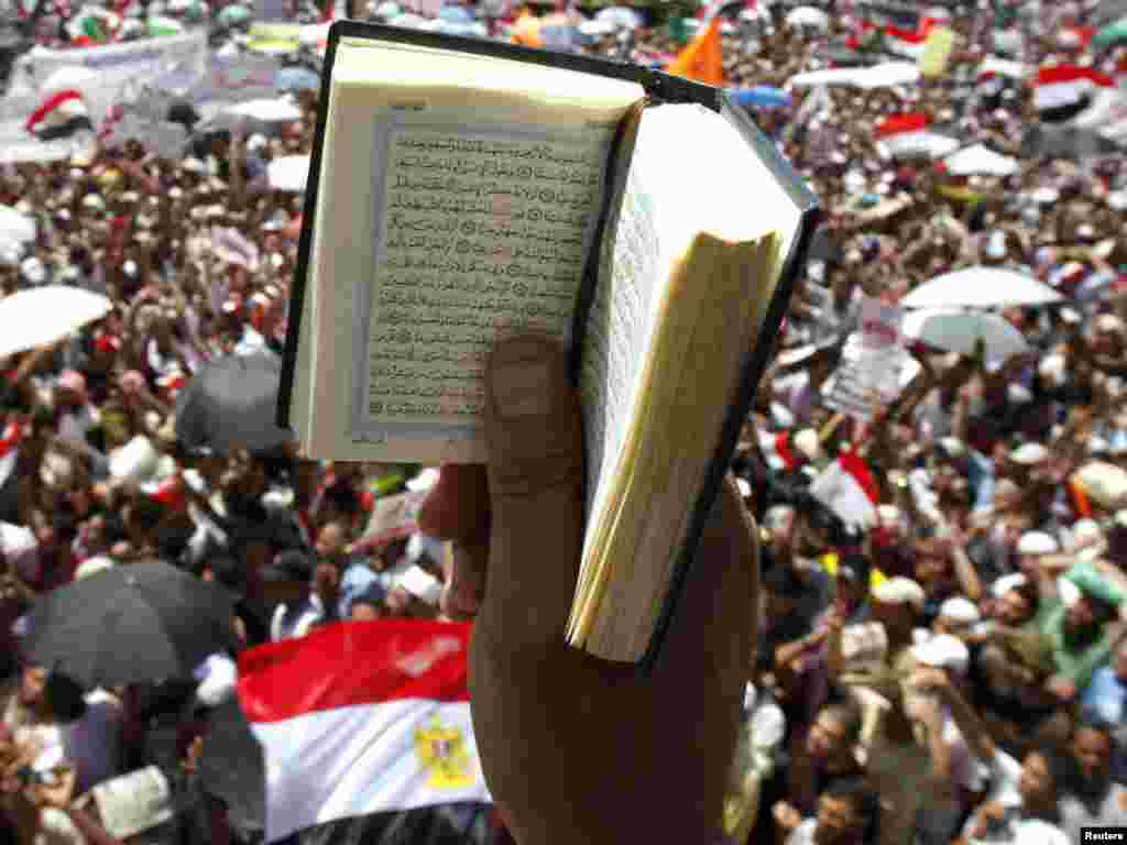 An Egyptian protester holds up a Koran while participating in a rally at Tahrir Square in Cairo on July 29. Photo by Mohamed Abd El-Ghany for Reuters