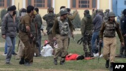 The body of a suspected militant following an attack against Indian paramilitary personnel in Srinagar.