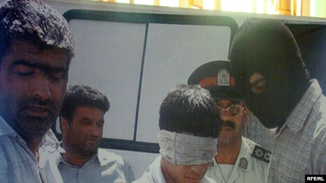 A screen grab of materials from a conference on Afghan youths executed in Iran in October 2009