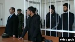 Таджикские студенты, обвиняемые в участии в боях в Сирии, в зале суда. Душанбе, декабрь 2013 года.