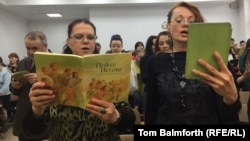 Jehovah's Witnesses sings hymns during a service. in Russia in April 2017.