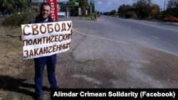 A Crimean Tatar man carries out a single-person protest against Russia's occupation of Crimea on October 14.