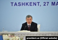 Uzbek President Shavkat Mirziyoev attends a multilateral meeting on Afghanistan aiming to lay the ground for direct talks between Kabul and the Taliban, in Tashkent in March 2018.