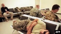 A U.S. soldier sleeps as he awaits a flight at the International Security Assistance Force (ISAF) airport in Kabul in September 2009.