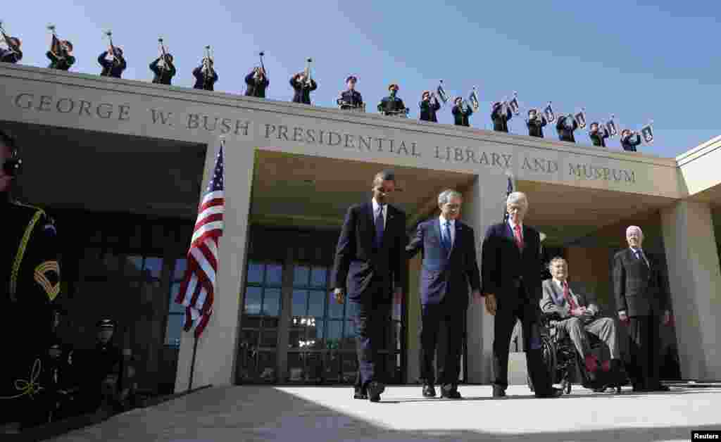 U.S. President Barack Obama (left) walks alongside former Presidents George W. Bush, Bill Clinton, George Bush, and Jimmy Carter as they attend the dedication ceremony for the George W. Bush Presidential Center in Dallas. (Reuters/Jason Reed)