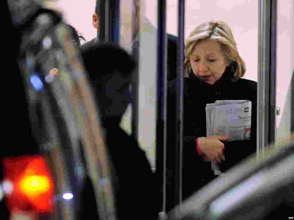 U.S. Secretary of State Hillary Clinton departs a New York hospital after visiting her ailing husband. - Former U.S. President Bill Clinton had an emergency operation to clear a blocked coronary artery.