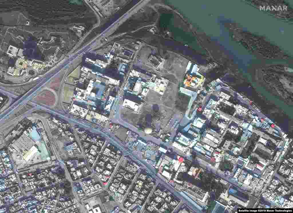 These satellite images show a hospital and hotel in Mosul, Iraq on November 13, 2015, before Islamic State (IS) militants invaded the city and then the same area on July 8, 2017, after IS destroyed much of this part of the city. U.S.-led coalition forces battled the militants, liberating IS-held territory by March 2019.