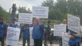 A demonstration by metal workers in Kutaisi is broken up on September 16.