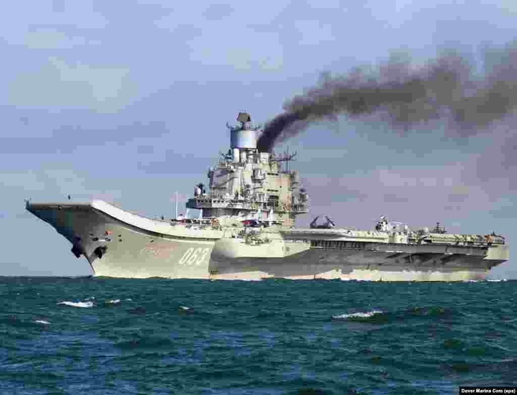 The Admiral Kuznetsov, billowing smoke as it passes through the English Channel on October 21, 2016. The diesel-powered carrier has attracted ridicule on Russian social media for its plume of black exhaust, but the apparent purpose of the vessel's mission to Syria is deadly serious.