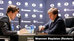 Magnus Carlsen (left) faces Sergei Karjakin in the World Chess Championship final in New York City on November 30.