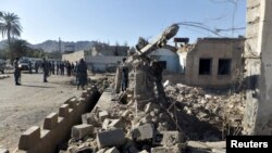 FILE: The site of a Taliban attack in Farah.