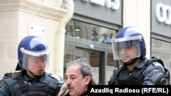 Riot police broke up the April 2 protest in downtown Baku.